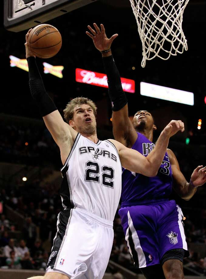 The Spurs' Tiago Splitter (22) goes in for a dunk against Sacramento Kings' Jason Thompson (34) in the second half at the AT&T Center on Friday, Mar. 1, 2013. Spurs defeated the Kings, 130-102. Photo: Kin Man Hui, San Antonio Express-News / © 2012 San Antonio Express-News