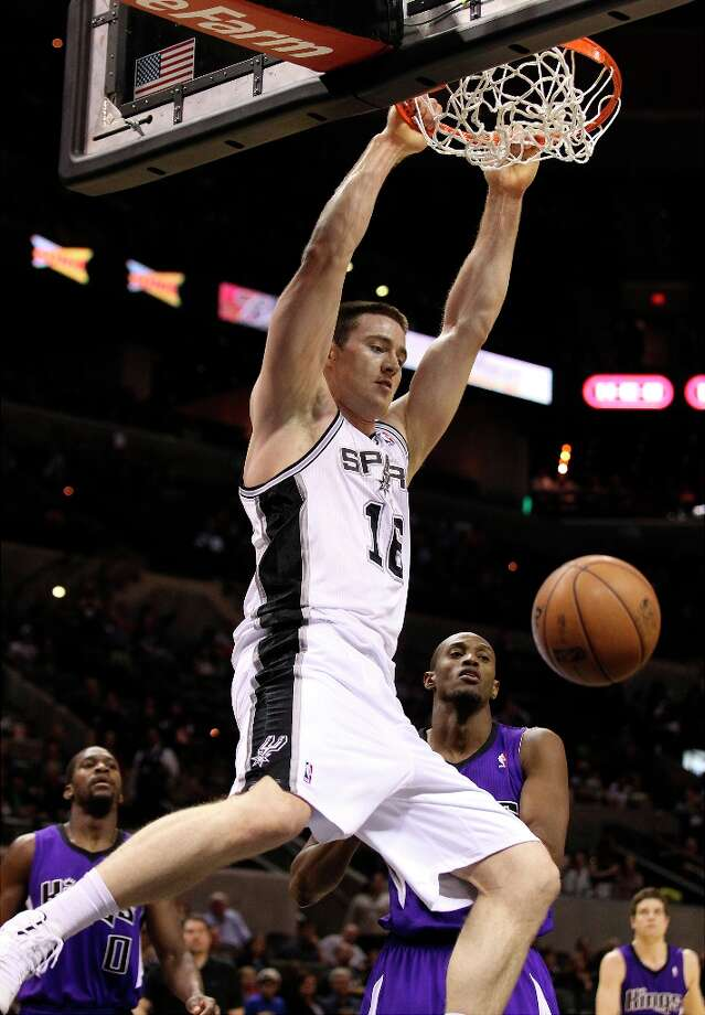 The Spurs' Aron Baynes (16) dunks against the Sacramento Kings in the second half at the AT&T Center on Friday, Mar. 1, 2013. Spurs defeated the Kings, 130-102. Photo: Kin Man Hui, San Antonio Express-News / © 2012 San Antonio Express-News