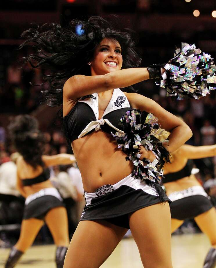 Spurs Silver Dancers perform during the game against the Sacramento Kings in the second half at the AT&T Center on Friday, Mar. 1, 2013. Spurs defeated the Kings, 130-102. Photo: Kin Man Hui, San Antonio Express-News / © 2012 San Antonio Express-News