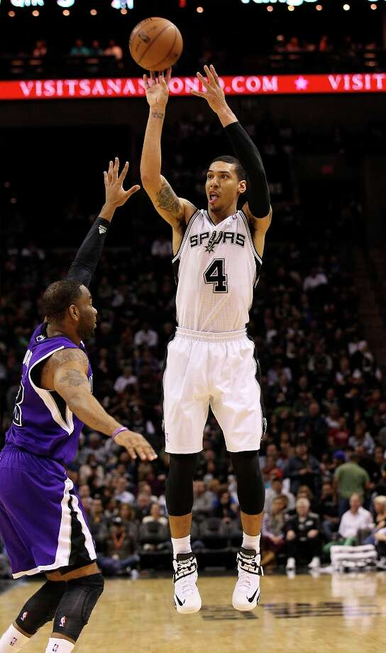 The Spurs' Danny Green (4) attempts a three-pointer against Sacramento Kings' Aaron Brooks (3) in the second half at the AT&T Center on Friday, Mar. 1, 2013. Spurs defeated the Kings, 130-102. Photo: Kin Man Hui, San Antonio Express-News / © 2012 San Antonio Express-News