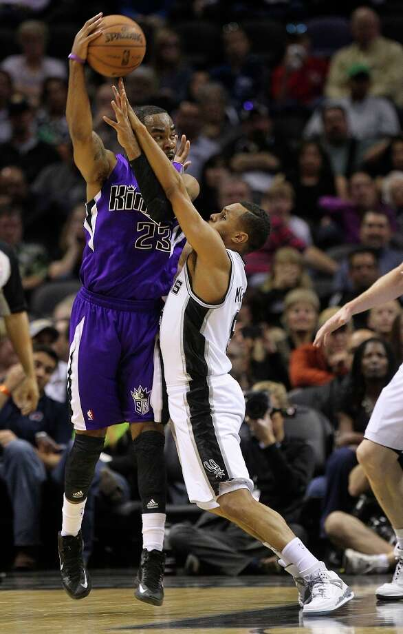 The Spurs' Patty Mills (8) defends against Sacramento Kings' Marcus Thornton (23) in the second half at the AT&T Center on Friday, Mar. 1, 2013. Spurs defeated the Kings, 130-102. Photo: Kin Man Hui, San Antonio Express-News / © 2012 San Antonio Express-News