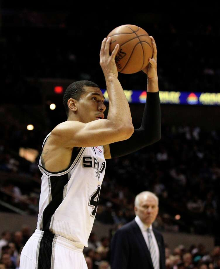 The Spurs' Danny Green (04) attempts a three-pointer against the Sacramento Kings in the first half at the AT&T Center on Friday, Mar. 1, 2013. Photo: Kin Man Hui, San Antonio Express-News / © 2012 San Antonio Express-News