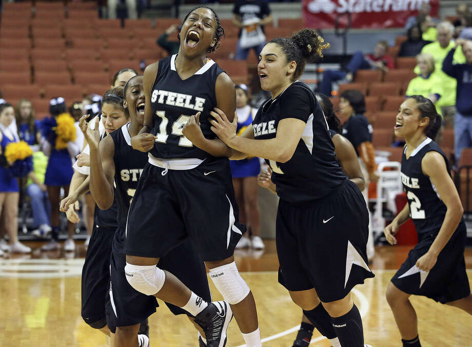 Baylor recruit McKenzie Calvert (14) jumps for joy as Steele advanced to the Class 5A state final against Duncanville. Calvert led four players in double figures with 17 points. Photo: Tom Reel / San Antonio Express-News