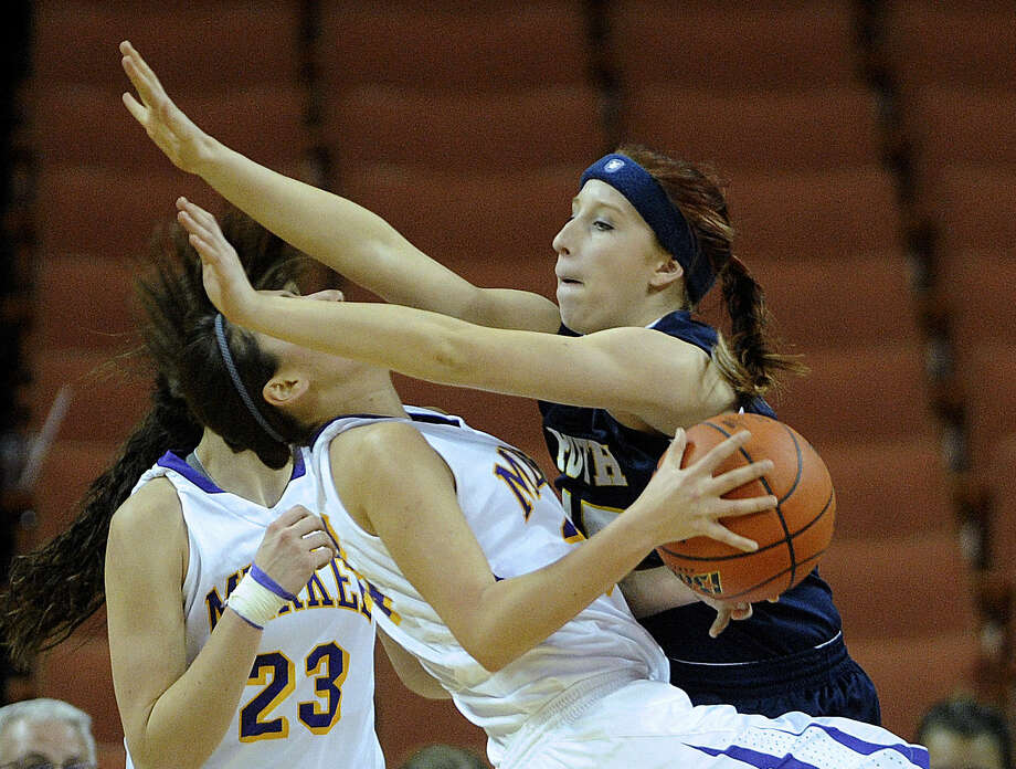 Merkel's Shelby Jasso (center) is fouled by Poth's Shelby Yanta during their 2A state semifinal. The six Pirette seniors played at state each year in high school. Photo: Billy Calzada / San Antonio Express-News