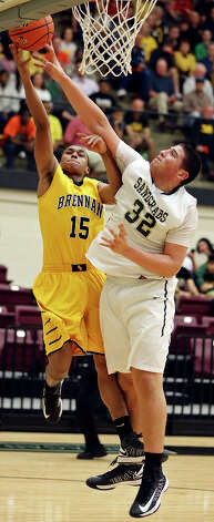 Brennan's Dave Holdipp shoots around Port Lavaca Calhoun's Isaac Cardona during second half action of their Region IV-4A semifinal game Friday March 1, 2013 at Littleton Gym. Brennan won 63-42. Photo: Edward A. Ornelas, Edward A. Ornelas / San Antonio Express-News / © 2013 San Antonio Express-News