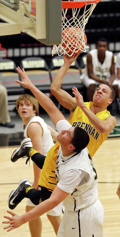 Brennan's John Azzinaro shoots over Port Lavaca Calhoun's Isaac Cardona during first half action of their Region IV-4A semifinal game Friday March 1, 2013 at Littleton Gym. Photo: Edward A. Ornelas, Edward A. Ornelas / San Antonio Express-News / © 2013 San Antonio Express-News