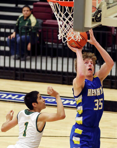 Alamo Heights' Wes Miller shoots over Laredo Nixon's Gabriel Rodriguez during first half action of their Region IV-4A semifinal game Friday March 1, 2013 at Littleton Gym. Photo: Edward A. Ornelas, Edward A. Ornelas / San Antonio Express-News / © 2013 San Antonio Express-News
