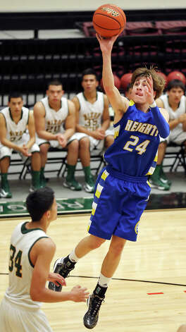 Alamo Heights' Max Riemenschneider shoots over Laredo Nixon's Rolando Bustamante during first half action of their Region IV-4A semifinal game Friday March 1, 2013 at Littleton Gym. Photo: Edward A. Ornelas, Edward A. Ornelas / San Antonio Express-News / © 2013 San Antonio Express-News