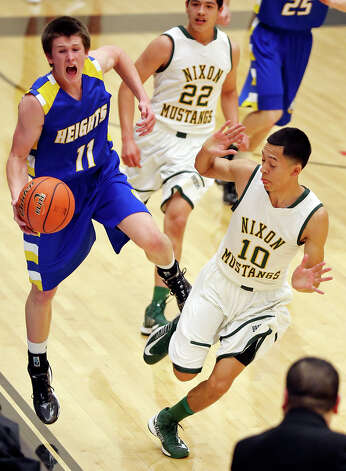 Alamo Heights' David Favorite grabs for a loose ball against Laredo Nixon's Ricky Arana during first half action of their Region IV-4A semifinal game Friday March 1, 2013 at Littleton Gym. Photo: Edward A. Ornelas, Edward A. Ornelas / San Antonio Express-News / © 2013 San Antonio Express-News