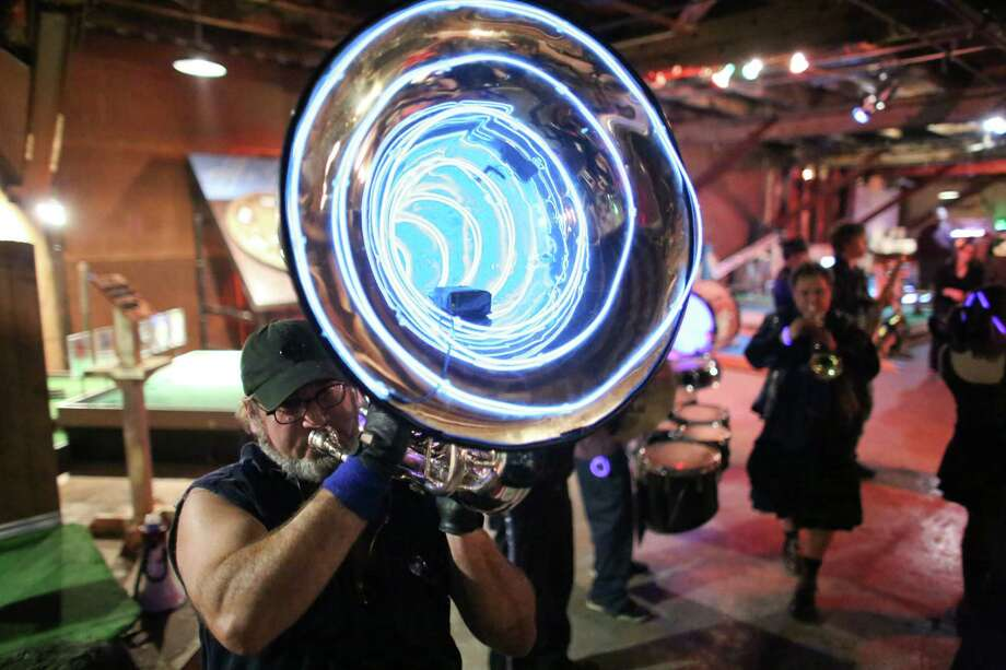 Scott Bloom plays his marching tuba during the kickoff night of Smash Putt on Friday, March 1, 2013 in Seattle's Sodo neighborhood. Smash Putt is like mini-golf with the added challenges of negotiating laser beams, power tools and other mechanical obstacles. Plus, you can play it while downing a beer. Photo: JOSHUA TRUJILLO / SEATTLEPI.COM