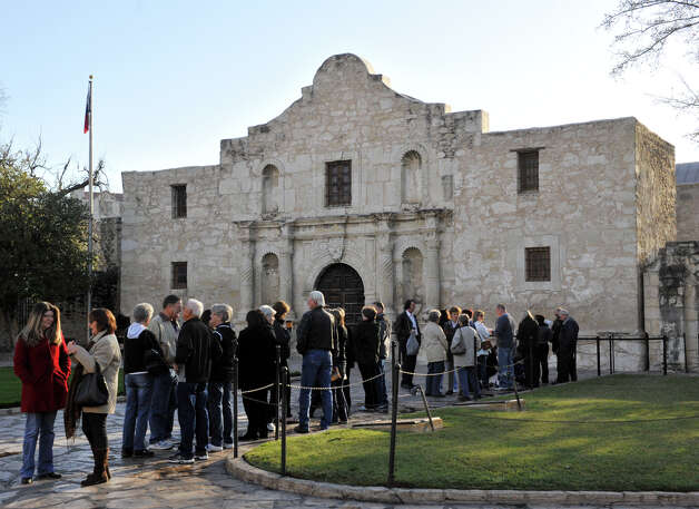 The line formed early Friday to see the Alamo display of the famed William Barret Travis letter. Photo: Robin Jerstad, For The Express-News / San Antonio Express-News