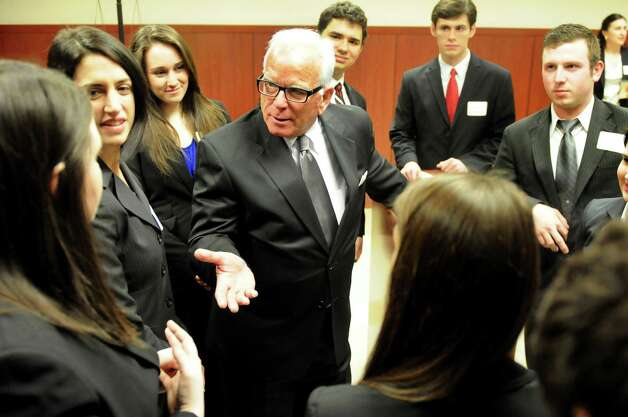 Professor Leonard Cutler, center, briefs his pre-law students before the ceremony to open the school's new courtroom on Friday, March 1, 2013, at Siena College in Loudenville, N.Y. The students compete on the Moot Court / Mock Trial Team and will hold court proceedings in the new room. School alumni Jay Girvin and Sal Ferlazzo funded the design and development of the room. (Cindy Schultz / Times Union) Photo: Cindy Schultz / 00021359A