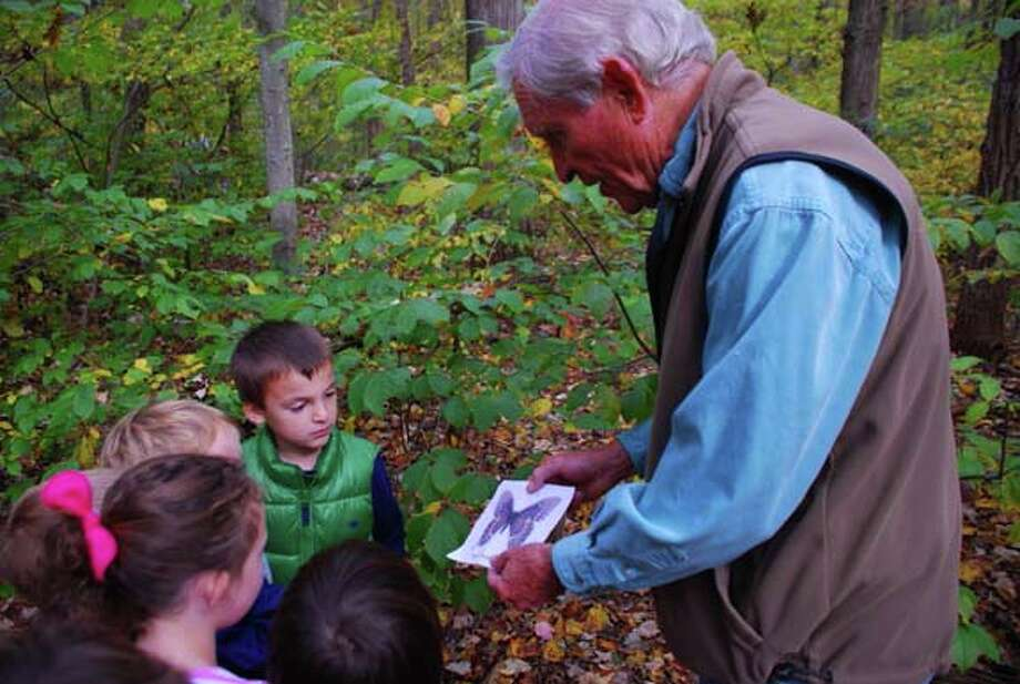 Darien Land Trust President Chris Filmer, at right, spoke with children of the Holly Pond Pre-School on a tour of Dunlap Woods, which the land trust oversees. Photo: Contributed