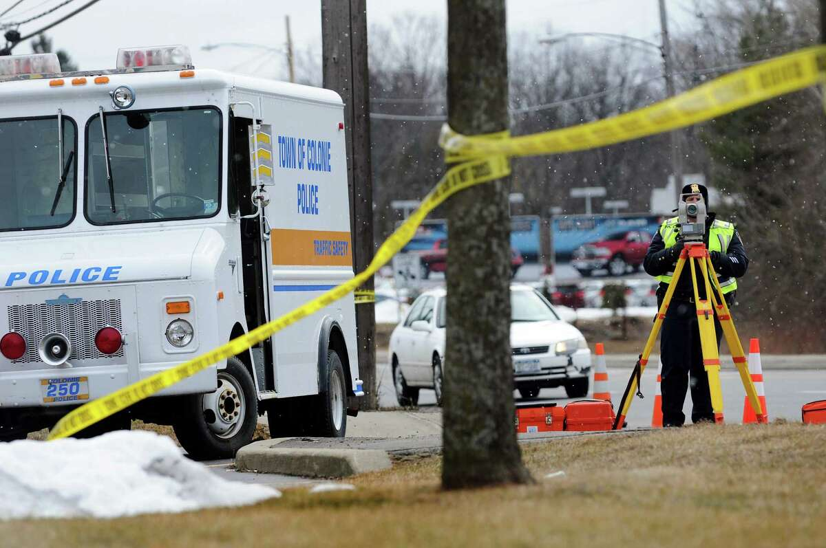 Colonie Police use survey equipment to map out a fatal accident at Central Avenue and Lombard Street on Saturday, March 2, 2013, in Colonie, N.Y. (Cindy Schultz / Times Union)