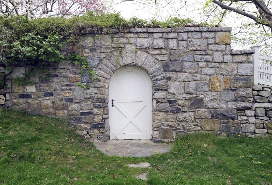 A wooden gate and stone wall on North Porchuck Road, Greenwich, Wednesday, April 27, 2011.