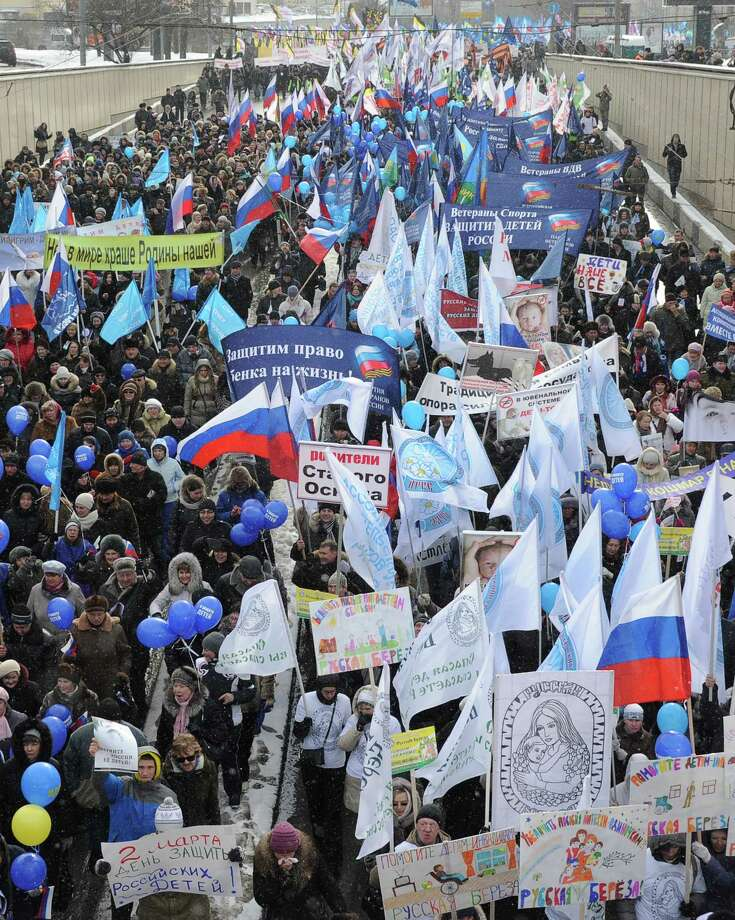 Activists from pro-Kremlin children's advocacy groups march through Moscow on March 2, 2013 to call on authorities to ban all foreign adoptions and demand the return of an adopted boy whose brother died in Texas. Photo: ALEXANDER NEMENOV, AFP/Getty Images / AFP