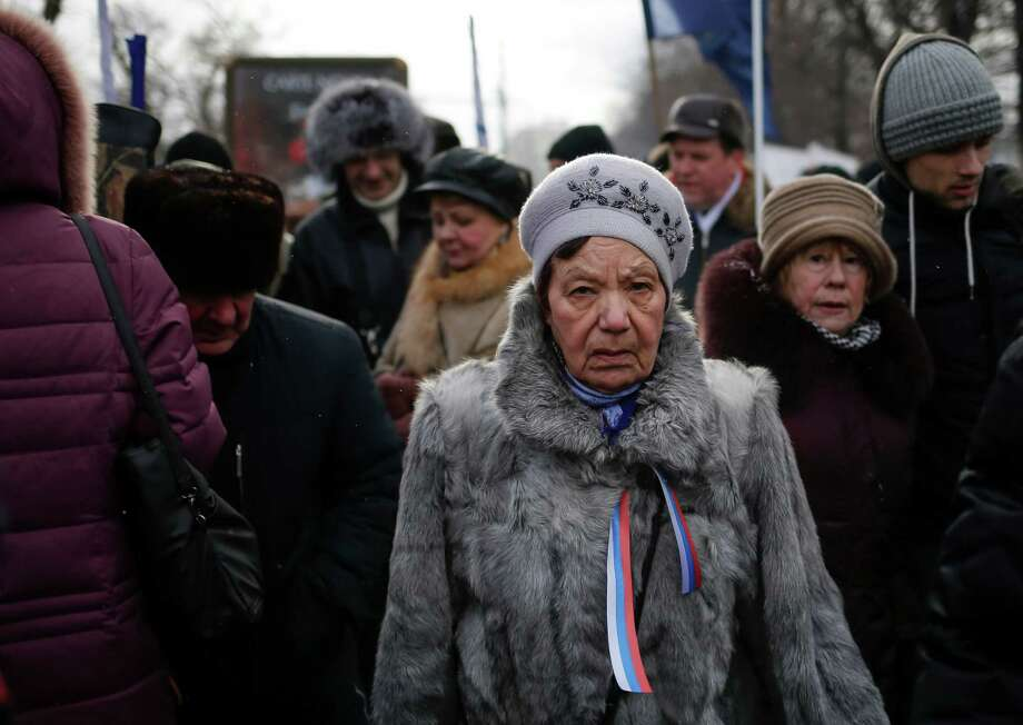 Demonstrators leave after taking part in a massive rally to back the ban on U.S. adoptions of Russian children, in Moscow, Saturday, March 2, 2013. Russia voiced strong skepticism Saturday about the U.S. autopsy on Max Shatto, a 3-year-old adopted Russian boy in Texas and demanded further investigation as thousands rallied in Moscow to support the Kremlin ban on U.S. adoptions of Russian children. Photo: Alexander Zemlianichenko, Associated Press / AP
