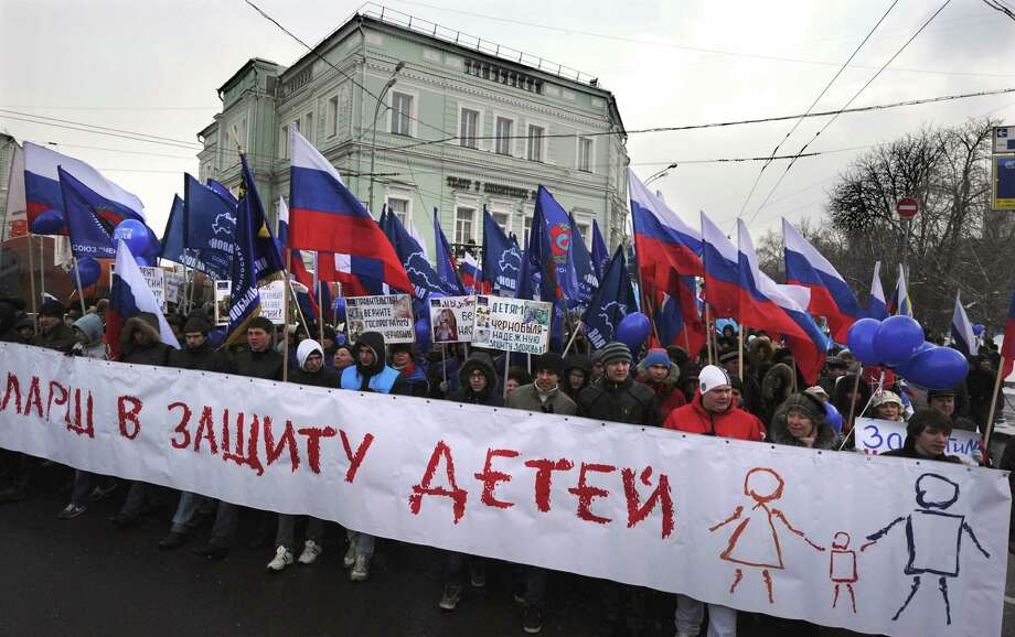 "Activists from pro-Kremlin children's advocacy groups march through Moscow on March 2, 2013 to call on authorities to ban all foreign adoptions and demand the return of an adopted boy whose brother died in Texas. The banner reads ""The March for Protection of the Children"". Photo: ALEXANDER NEMENOV, AFP/Getty Images / AFP"