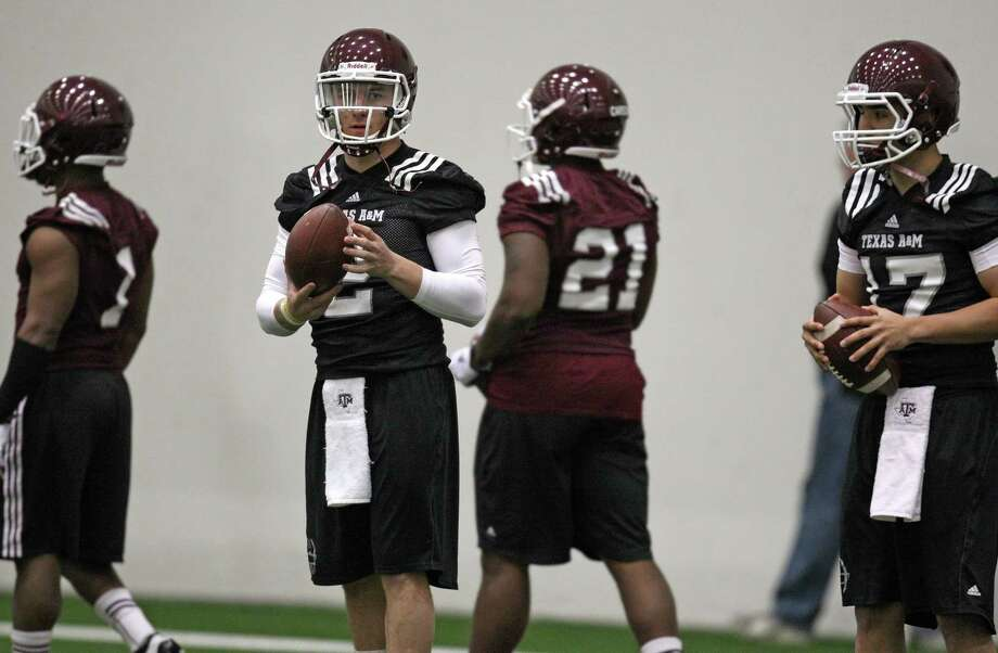 Texas A&M quarterback Johnny Manziel (left) during Spring football practice, Saturday, March 2, 2013 at the McFerrin indoor complex at Texas A&M University in College Station, TX. (Photo: Eric Christian Smith/For the Houston Chronicle) Photo: Eric Christian Smith, For The Chronicle