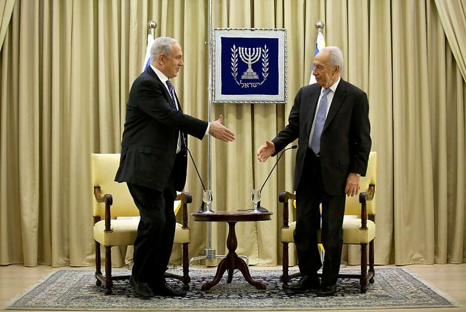 JERUSALEM, ISRAEL - MARCH 02:  Israeli Prime Minister Benjamin Netanyahu (L) and Israeli President Shimon Peres speak during a brief ceremony in the president's residence, on March 2, 2013 in Jerusalem, Israel. President Shimon Peres granted Prime Minister Benjamin Netanyahu two more weeks to form Israel's next government. Netanyahu asked for an extension after exhausting the 28-day timeframe to build a coalition.  (Photo by Uriel Sinai/Getty Images) Photo: Uriel Sinai, Getty Images