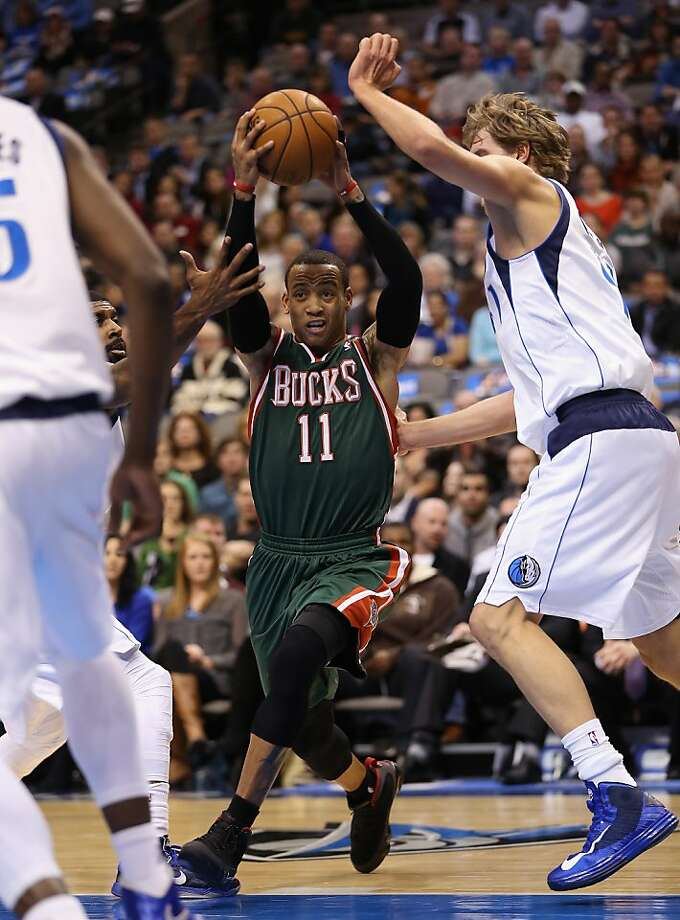 DALLAS, TX - FEBRUARY 26:  Monta Ellis #11 of the Milwaukee Bucks dribbles the ball against Dirk Nowitzki #41 of the Dallas Mavericks at American Airlines Center on February 26, 2013 in Dallas, Texas.  NOTE TO USER: User expressly acknowledges and agrees that, by downloading and or using this photograph, User is consenting to the terms and conditions of the Getty Images License Agreement.  (Photo by Ronald Martinez/Getty Images) Photo: Ronald Martinez, Getty Images