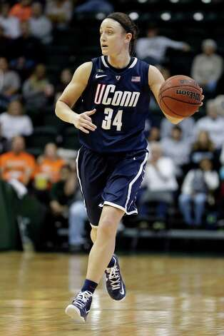 Connecticut guard Kelly Faris (34) during the second half of an NCAA women's college basketball game against South Florida Saturday, March 2, 2013, in Tampa, Fla. Connecticut won the game 85-51. (AP Photo/Chris O'Meara) Photo: Chris O'Meara, Associated Press / AP