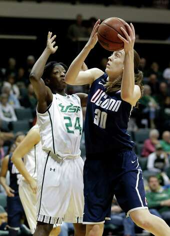 Connecticut forward Breanna Stewart (30) shoots over South Florida forward Alisia Jenkins (24) during the second half of an NCAA women's college basketball game Saturday, March 2, 2013, in Tampa, Fla. Connecticut won the game 85-51. (AP Photo/Chris O'Meara) Photo: Chris O'Meara, Associated Press / AP