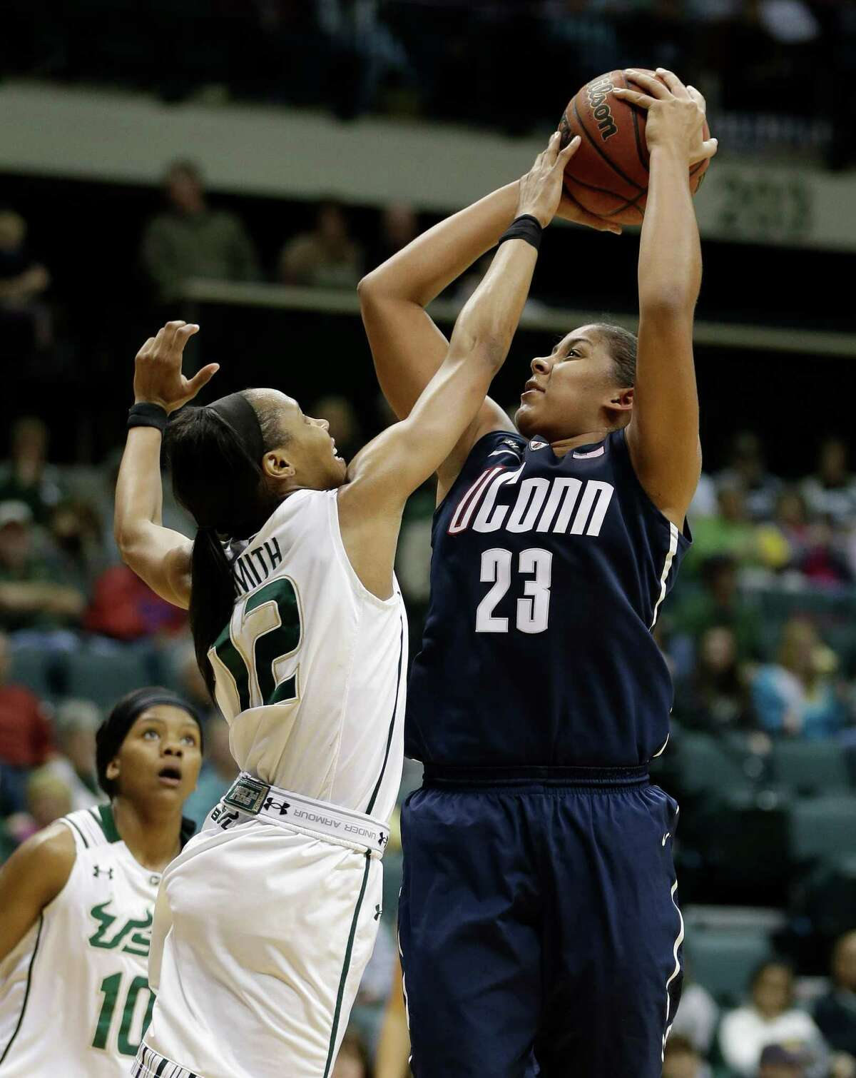 Connecticut forward Kaleena Mosqueda-Lewis (23) shoots over South Florida guard Andrell Smith (12) during the second half of an NCAA women's college basketball game Saturday, March 2, 2013, in Tampa, Fla. Connecticut won the game 85-51. (AP Photo/Chris O'Meara)