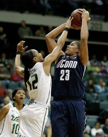 Connecticut forward Kaleena Mosqueda-Lewis (23) shoots over South Florida guard Andrell Smith (12) during the second half of an NCAA women's college basketball game Saturday, March 2, 2013, in Tampa, Fla. Connecticut won the game 85-51. (AP Photo/Chris O'Meara) Photo: Chris O'Meara, Associated Press / AP