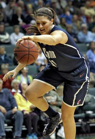 Connecticut center Stefanie Dolson (31) grabs a loose ball from South Florida during the second half of an NCAA women's college basketball game Saturday, March 2, 2013, in Tampa, Fla. Connecticut won the game 85-51. (AP Photo/Chris O'Meara) Photo: Chris O'Meara, Associated Press / AP