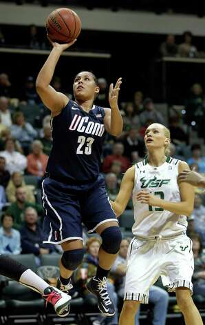 Connecticut forward Kaleena Mosqueda-Lewis (23) shoots past South Florida guard Inga Orekhova (13) during the second half of an NCAA college basketball game Saturday, March 2, 2013, in Tampa, Fla.  Mosqueda-Lewis had 32 points in UConn's 85-51 win. (AP Photo/Chris O'Meara) Photo: Chris O'Meara, Associated Press / AP