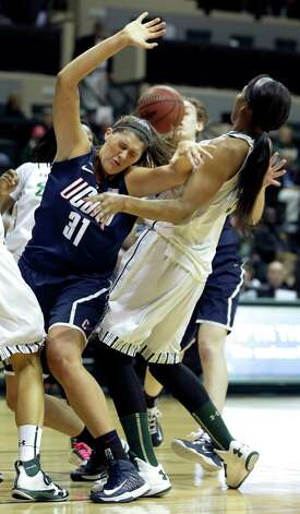 Connecticut center Stefanie Dolson (31) gets fouled by South Florida center Akila McDonald (32) during the first half of an NCAA college basketball game Saturday, March 2, 2013, in Tampa, Fla. (AP Photo/Chris O'Meara) Photo: Chris O'Meara, Associated Press / AP