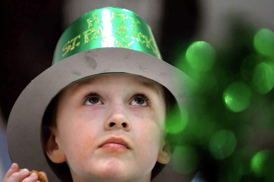 Jacob McLaughlin, 7, of East Greenbush wears a festive hat during the 9th annual Irish Fest on Saturday, March 2, 2013, at St. Francis of Assisi Church in Albany, N.Y. The event raises funds to tune and maintain the church's Casavant organ, which has phenominal sound quality. (Cindy Schultz / Times Union) Photo: Cindy Schultz / 00021214A