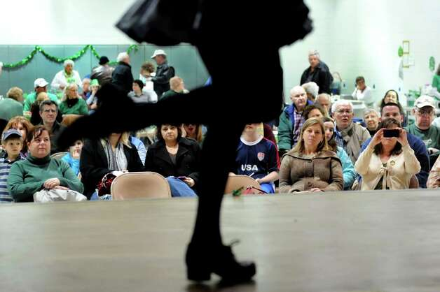 The Farrell School of Irish Dance entertains the crowd during the 9th annual Irish Fest on Saturday, March 2, 2013, at St. Francis of Assisi Church in Albany, N.Y. The event raises funds to tune and maintain the church's Casavant organ, which has phenominal sound quality. (Cindy Schultz / Times Union) Photo: Cindy Schultz / 00021214A