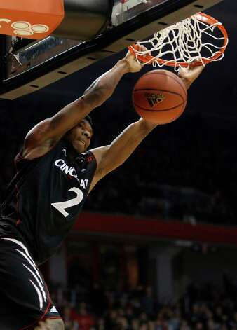 Cincinnati forward Titus Rubles (2) dunks the ball against Connecticut during the first half of an NCAA college basketball game, Saturday, March 2, 2013, in Cincinnati. (AP Photo/David Kohl) Photo: David Kohl, Associated Press / FR51830 AP