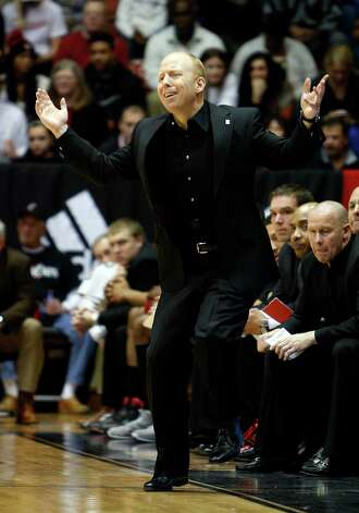 Cincinnati head coach Mick Cronin reacts during the second half of an NCAA college basketball game against Connecticut, Saturday, March 2, 2013, in Cincinnati. Cincinnati won 61-56. (AP Photo/David Kohl) Photo: David Kohl, Associated Press / FR51830 AP