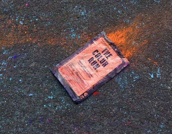 A portable packet of colored powder is discarded in the parking lot during the Color Run 5K run at Candlestick Park in San Francisco, Calif. on Saturday, March 2, 2013. Photo: Paul Chinn, The Chronicle