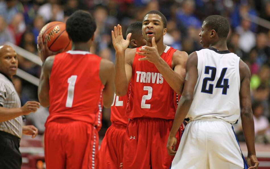 Fort Bend Travis' Aaaron Harrison (2) celebrates teammate John Burnett's (1) recovery of a turnover