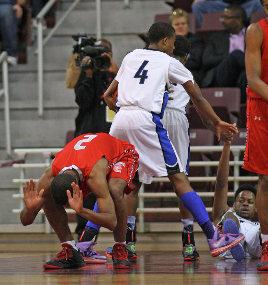 Fort Bend Travis' Aaron Harrison (2) slaps the court in frustration after being called for a foul. Photo: Eric Christian Smith, For The Chronicle