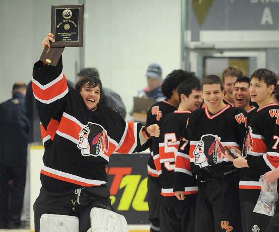 Watertown/Pomperaug goalie Trevor St. Onge holds up the SWC champion plaque after his team's 5-1 win over Brookfield/Bethel/Danbury in the boys SWC hockey championship at Danbury Arena Saturday, March 2, 2013.  St. Onge was MVP of the tournament. Photo: Tyler Sizemore / The News-Times