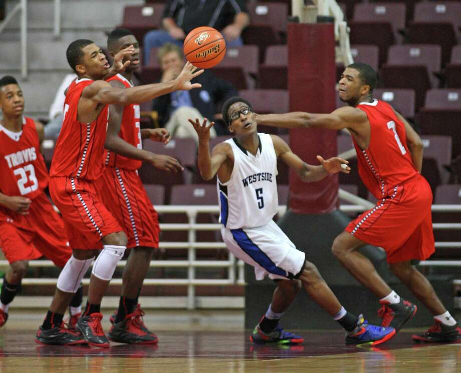 Fort Bend Travis' Andrew Harrison (left) and teammate and brother Aaron Harison (right) fights for a loose ball with Westfield's Robert Hatter IV (center). Photo: Eric Christian Smith, For The Chronicle