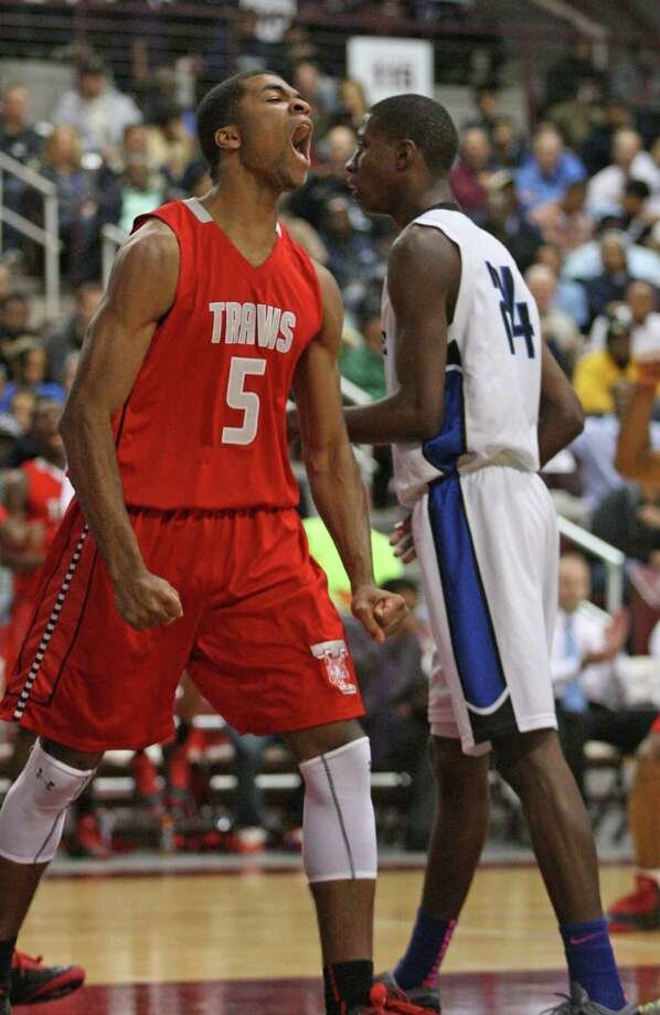 Fort Bend Travis' Andrew Harrison yells after scoring. Photo: Eric Christian Smith, For The Chronicle
