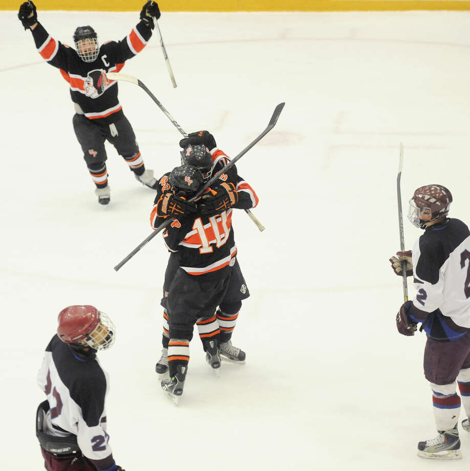 Watertown/Pomperaug celebrate a first period goal by Jon Manzer during its 5-1 win over Brookfield/Bethel/Danbury in the boys SWC hockey championship at Danbury Arena Saturday, March 2, 2013. Photo: Tyler Sizemore / The News-Times