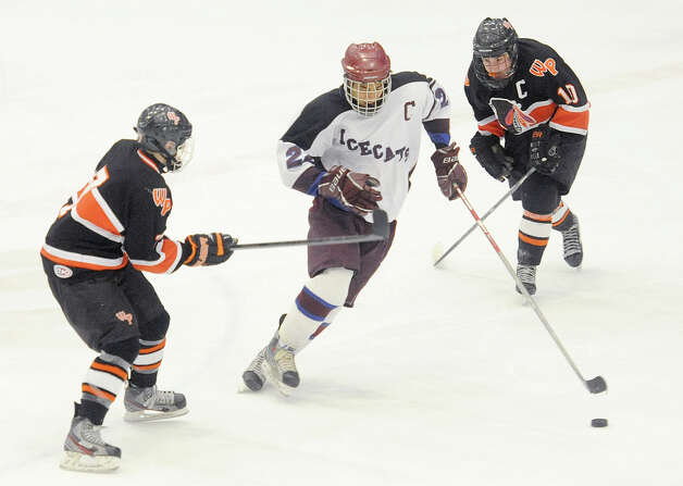 Brookfield/Bethel/Danbury's Jordan Warren, center, splits Watertown/Pomperaug defenders Jon Manzer, left, and Kyle Block during Watertown/Pomperaug's 5-1 win over Brookfield/Bethel/Danbury in the boys SWC hockey championship at Danbury Arena Saturday, March 2, 2013. Photo: Tyler Sizemore / The News-Times