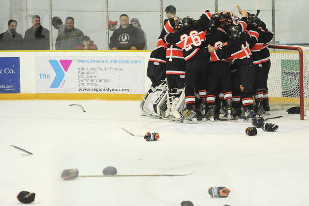Watertown/Pomperaug celebrates after its 5-1 win over Brookfield/Bethel/Danbury in the boys SWC hockey championship at Danbury Arena Saturday, March 2, 2013. Photo: Tyler Sizemore / The News-Times