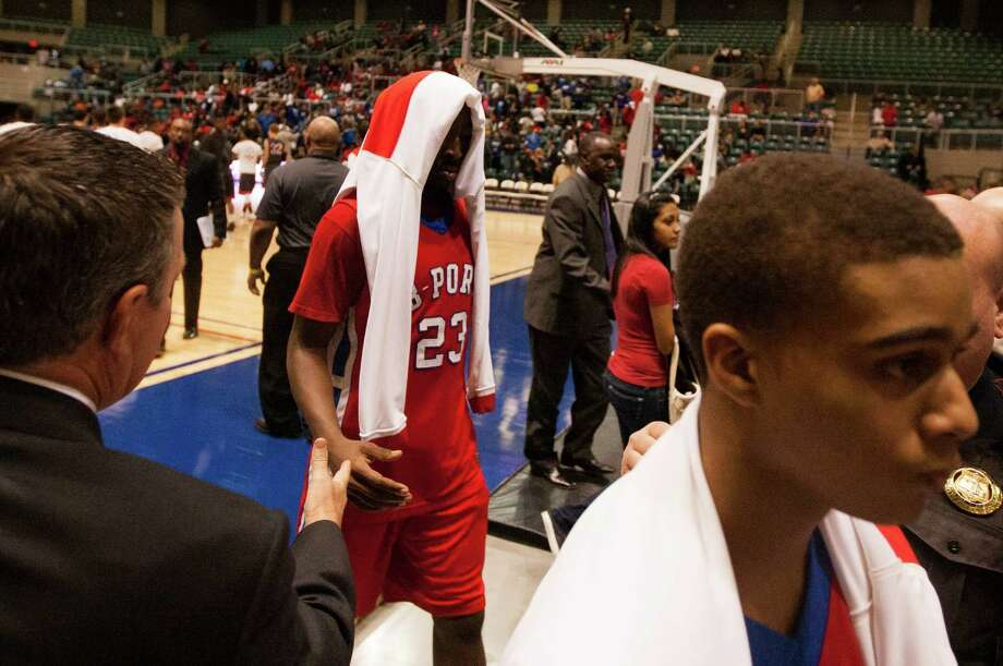 Brazosport guard Cameron Fisher walks off the court after losing to Georgetown during the 4A Region III tournament at the Merrell Center