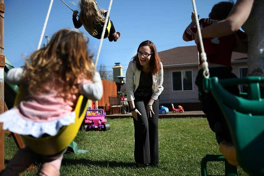 Kelly Dwyer (center), member of San Francisco's Democratic County Central Committee, pushes her daughter Saoirse Dwyer (left foreground) , 2, on a swing at the home of her friend Anna Buckley (partially seen at right), as she plays on a swing with Buckley's children Tara Buckley, 4 (upper second from left) and Evan Buckley (second from right), 2, before leaving for work on Friday, March 1, 2013 in San Bruno, Calif. Photo: Lea Suzuki, The Chronicle