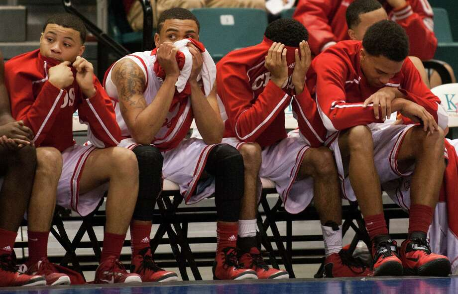 The Crosby bench watches as they lose to B.F. Terry 66-49 during the 4A Region III tournament at the Merrell Center on Friday, March 1, 2013, in Katy. Photo: J. Patric Schneider, For The Chronicle / © 2013 Houston Chronicle