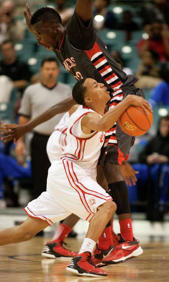 Crosby guard TJ Stewart (white) collides with Terry forward Derrick Griffin during the fourth quarter of the 4A Region III tournament at the Merrell Center on Friday, March 1, 2013, in Katy. Photo: J. Patric Schneider, For The Chronicle / © 2013 Houston Chronicle