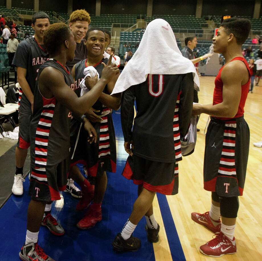 The B.F. Terry Rangers celebrate after defeating Crosby 66-49 during the 4A Region III tournament at the Merrell Center on Friday, March 1, 2013, in Katy. Photo: J. Patric Schneider, For The Chronicle / © 2013 Houston Chronicle